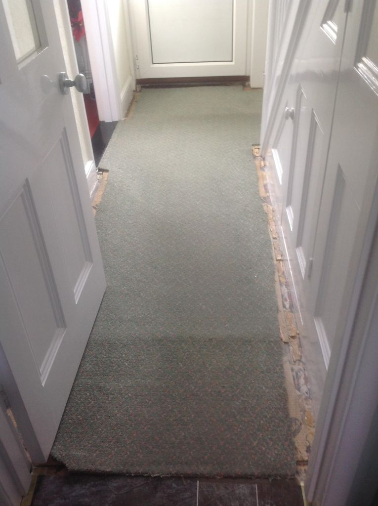 Edwardian Tiled Hallway Covered in Carpet and Before Restoration in Chippenham