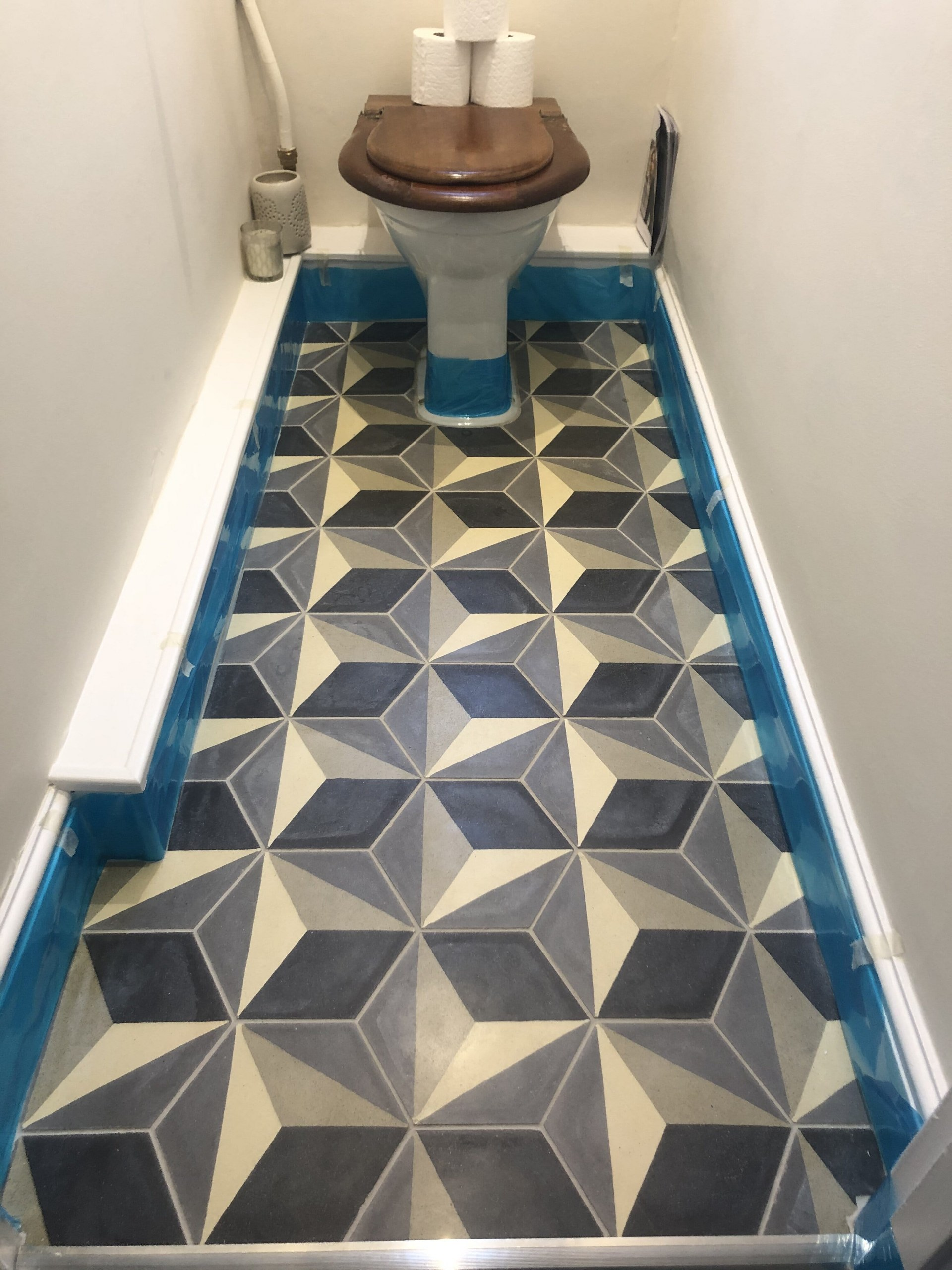 Encaustic Tiled Bathroom Floor Before Renovation in Histon